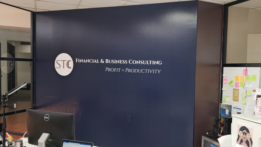 Custom wallpaper of STC logo and slogan installed by ALTIUS.